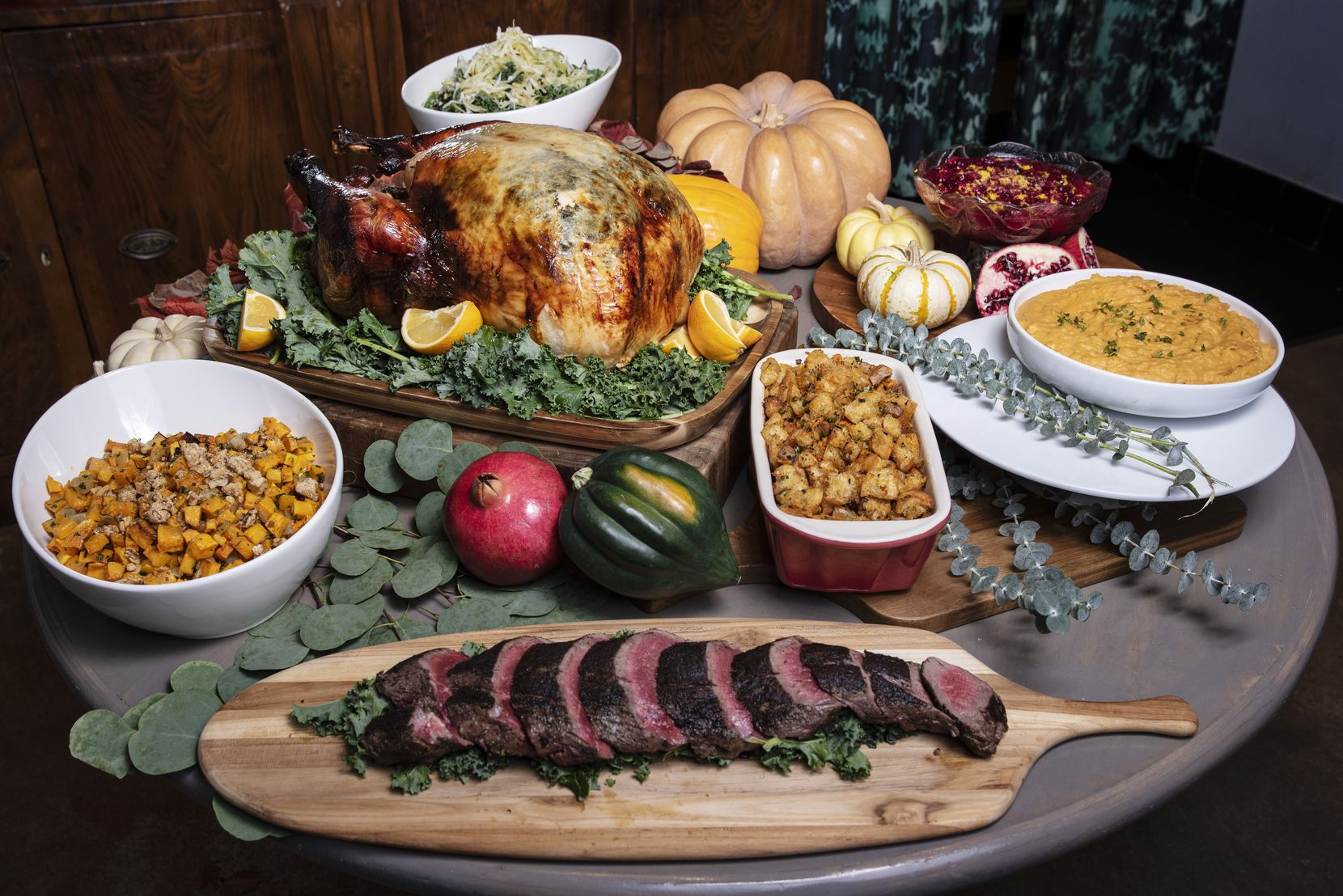 Herbed and brined turkey, seasoned and seared grass-fed beef tenderloin and sides are offered as part of Dive Coastal Cuisine's holiday menu this year.