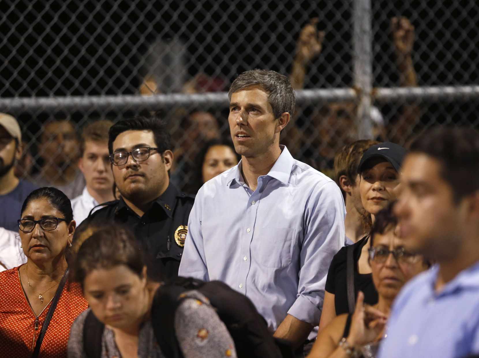 Democratic presidential candidate Beto O'Rourke listened during a vigil at Ponder park in El Paso, Texas on Sunday, August 4, 2019. Less than a mile away is the scene where 20 people were shot and killed and 26 more were wounded at a Walmart in El Paso on Saturday. (Vernon Bryant/The Dallas Morning News)