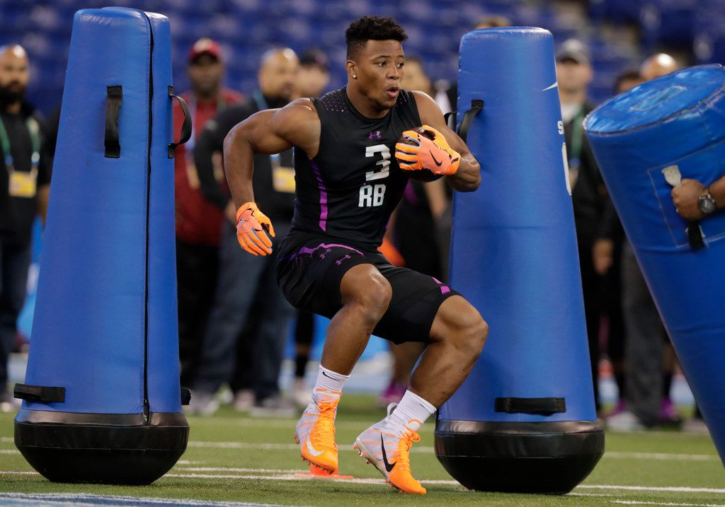 Penn State running back Saquon Barkley runs a drill at the NFL football scouting combine in Indianapolis, Friday, March 2, 2018. (AP Photo/Michael Conroy)