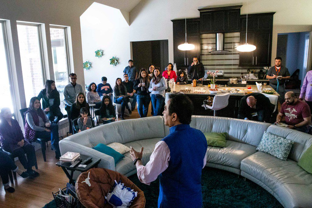 Raj Asava talks to a group about the Indian American Council for the North Texas Food Bank at a home gathering in Frisco. (Shaban Athuman/The Dallas Morning News)