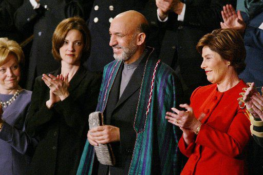 Laura Bush stood next to Hamid Karzai as President George W. Bush acknowledged the Afghan leader in his State of the Union address. (2002 File Photo/The Associated Press)