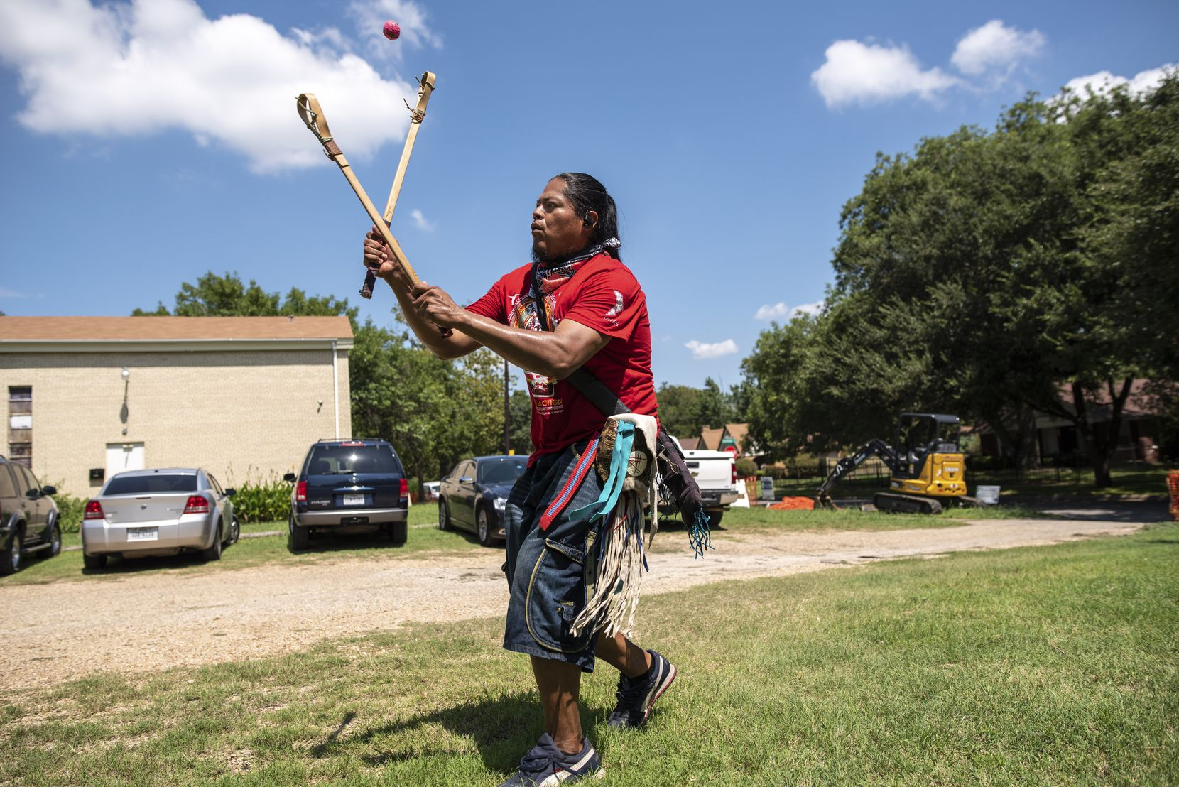 "Eli Hickman, 40, of the Choctaw/Navajo people, played a Native American stick ball game translated to ""Little Brother of War"" during a community awareness event hosted by American Indian Heritage Day in Texas on Saturday, Sept. 05, 2020 at the Dallas Indian Mission United Methodist Church."