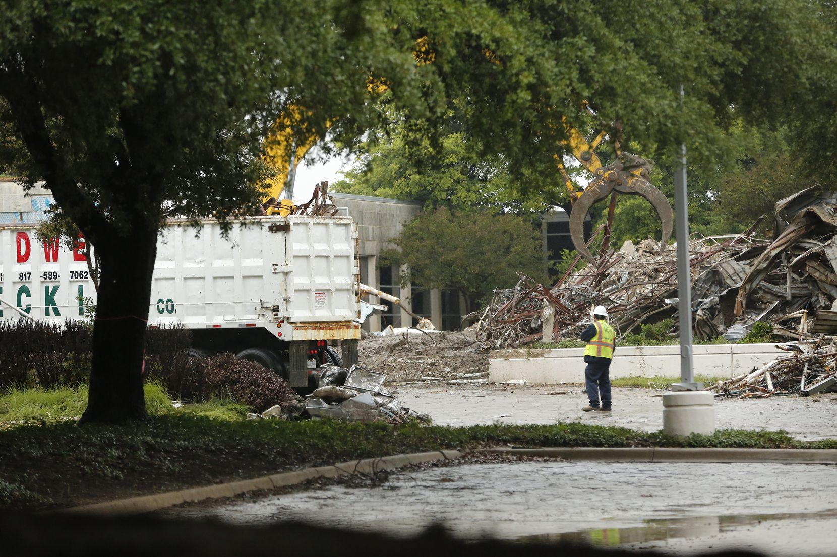 Work crews demolish the former headquarters of the Dallas Cowboys at Valley Ranch in Irving.