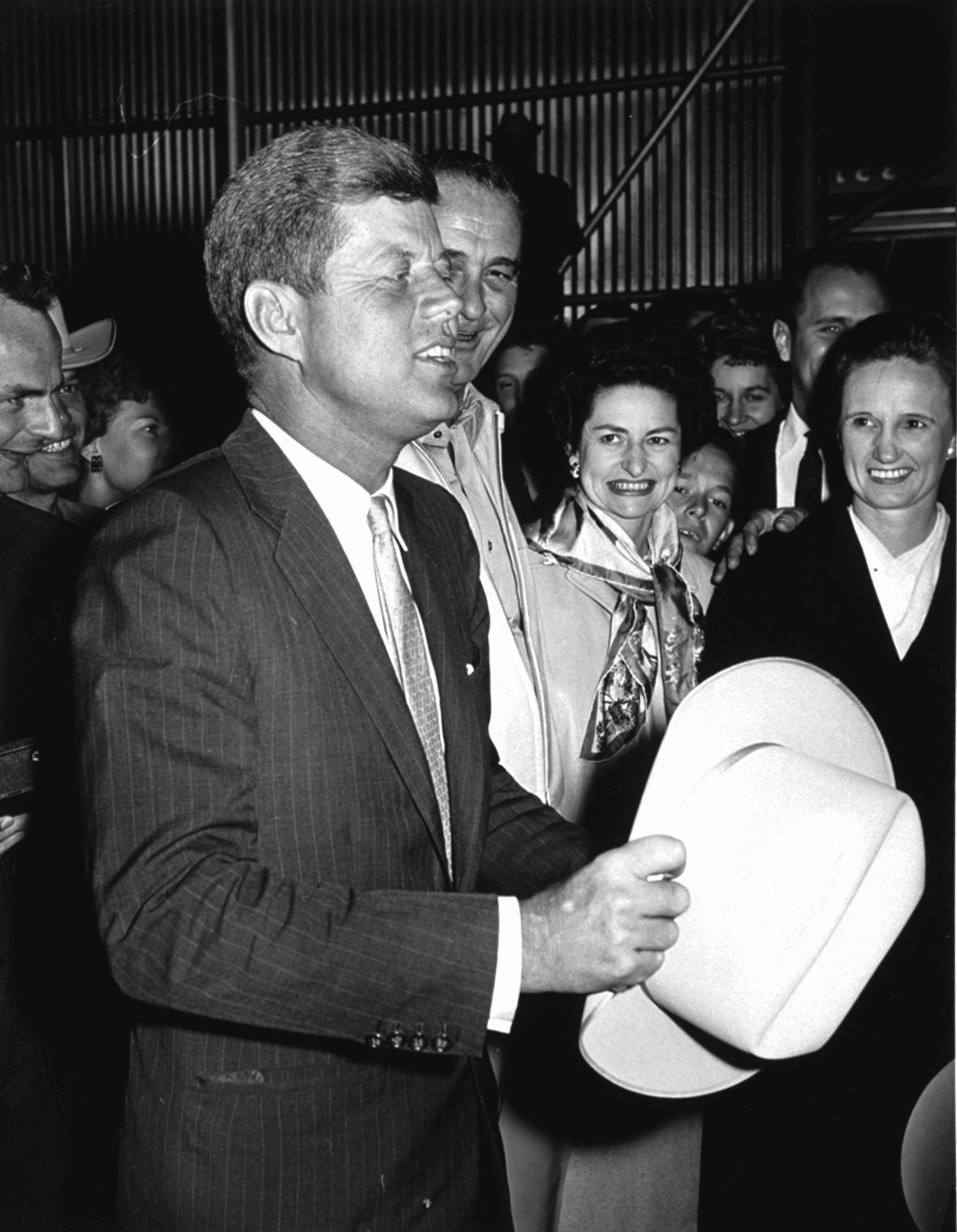 Sen. John F. Kennedy, then president-elect, thanked a Texas delegation from Blanco County and Stonewall for the Western hat they presented to him on his arrival at the LBJ Ranch on Nov. 16, 1960.  Sen. Lyndon B. Johnson, vice president-elect, and Lady Bird Johnson welcomed him.