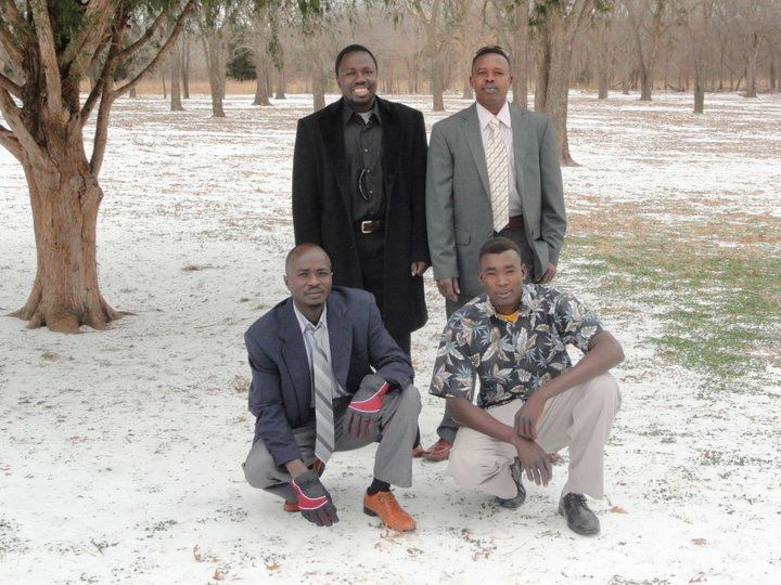 Mohammed Adam (left, kneeling) and Mohammed Ibrahim (left, standing) enjoyed a snow day in Dallas in 2011.