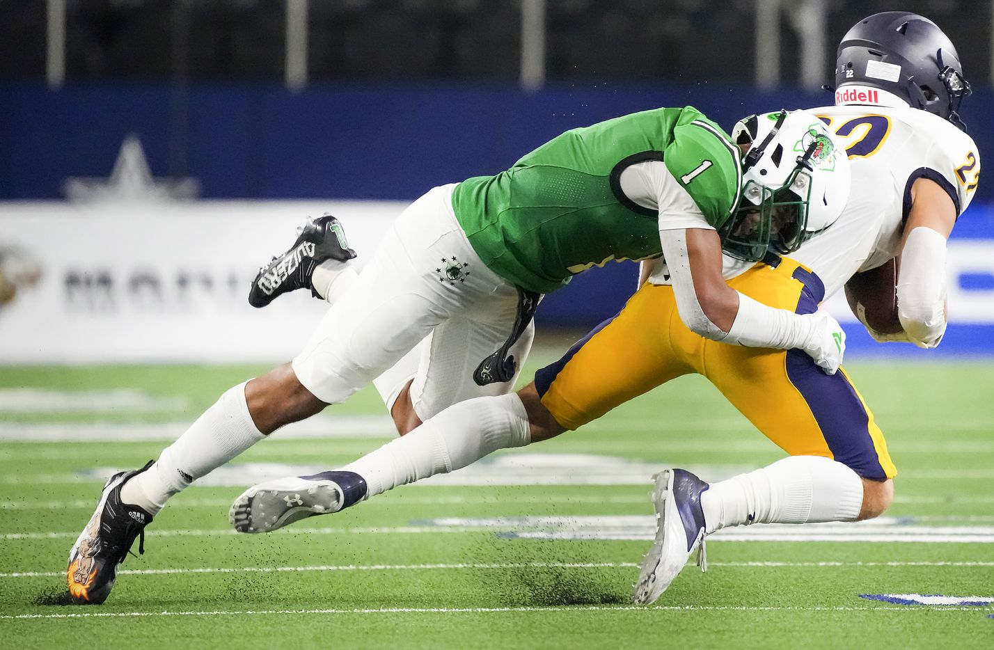 Southlake Carroll defensive back Avyonne Jones (1) brings down Highland Park's Luke Rossley (22) during the first half of a high school football game at AT&T Stadium on Thursday, Aug. 26, 2021, in Arlington.