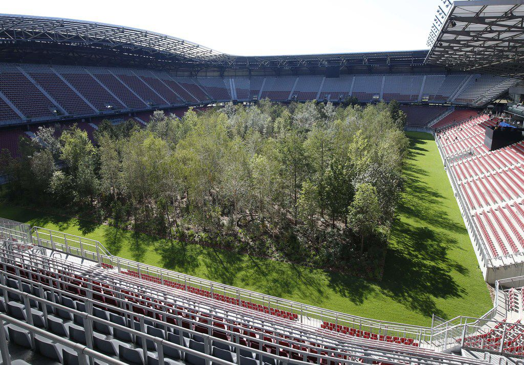 """TOPSHOT - General view taken on September 5, 2019 during a preview shows the temporary art intervention """"For Forest - The Unending Attraction of Nature"""" by Klaus Littmann at the Woerthsee football stadium in Klagenfurt, Austria. - The installation, consisting of around 300 trees transplanted over the existing football pitch, will be open to the public from September 8 to October 27, 2019. (Photo by GERT EGGENBERGER / APA / AFP) / Austria OUT / RESTRICTED TO EDITORIAL USE - MANDATORY MENTION OF THE ARTIST UPON PUBLICATION - TO ILLUSTRATE THE EVENT AS SPECIFIED IN THE CAPTIONGERT EGGENBERGER/AFP/Getty Images"""
