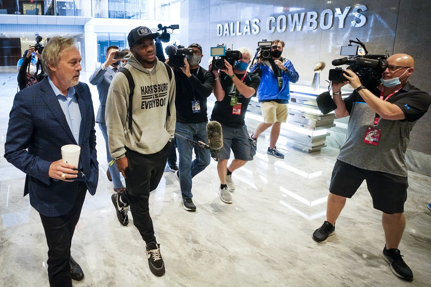 Dallas Cowboys first-round draft pick Micah Parsons, a linebacker from Penn State, gets a tour from senior vice president of public relations and communications Rich Dalrymple as he arrives at The Star on Friday, April 30, 2021, in Frisco. (Smiley N. Pool/The Dallas Morning News)