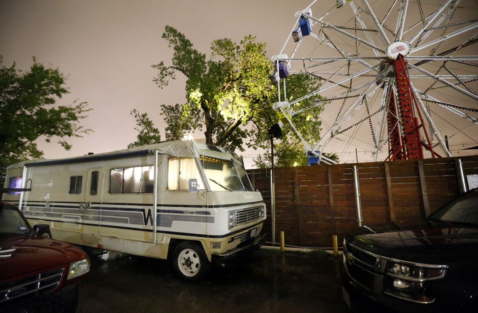 The ride at next-door Ferris Wheelers overlooks Jade Spa, and the camper where police found a man who claimed to be the spa's maintenance man.