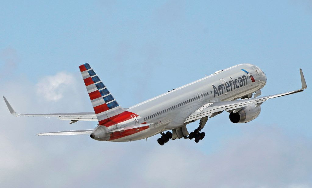 """FILE - In this 2016 file photo, an American Airlines passenger jet takes off from Miami International Airport in Miami. An American Airlines spokeswoman said reports coming out of North Carolina about medic call for """"passed gas"""" are false. (AP Photo/Alan Diaz, File)"""