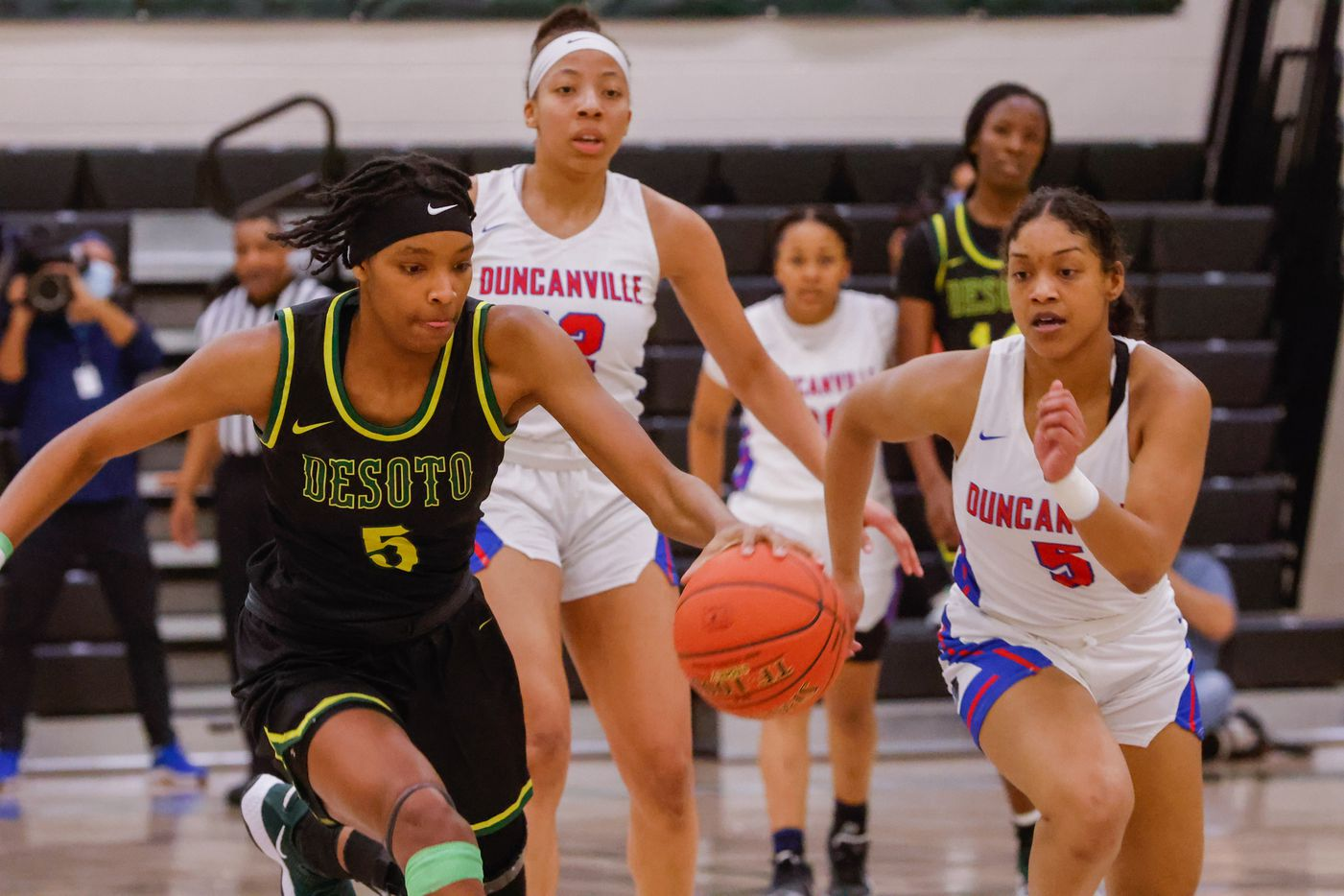 DeSoto's Sa'Myah Smith (5) drives past Duncanville's Kiyara Howard-Garza (5) during the first half of a UIL girls basketball Class 6A Region II in Waxahachie on Tuesday, March 2, 2021. (Juan Figueroa/ The Dallas Morning News)