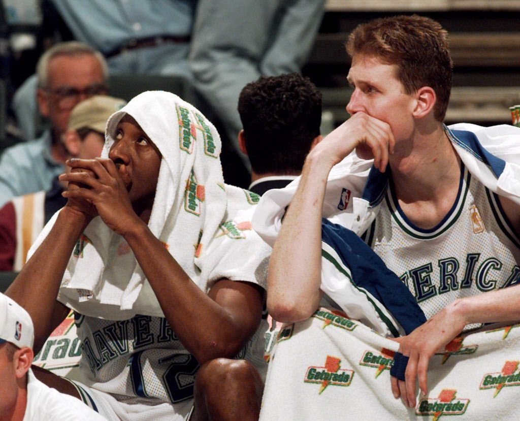ORG XMIT: ARL104 Dallas Mavericks starters, guard Derek Harper, left, and center Shawn Bradley watch from the bench during a loss in Dallas on April 12, 1997. Dallas finished the season with a record of 24-58.
