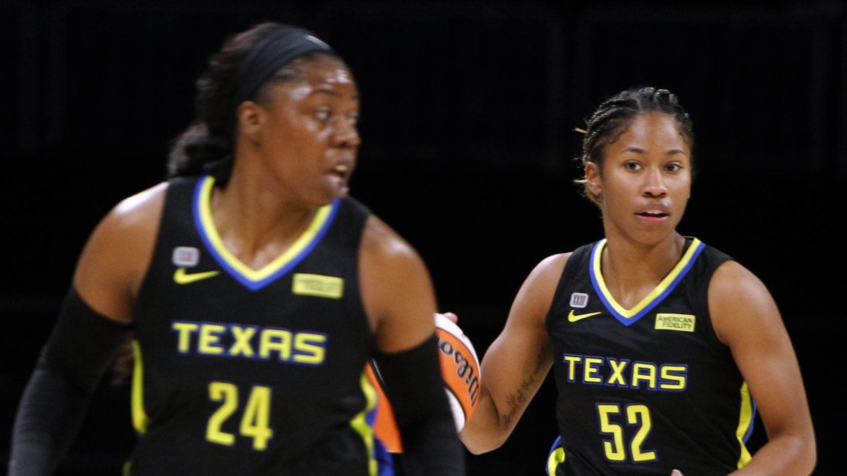 Dallas Wings guard Tyasha Gray (52), right, brings the ball up-court behind guard Arike Ogunbowale (24) during first half action against the Atlanta Dream. Dallas lost to Atlanta 69-64. The two teams played their WNBA game at College Park Center on the campus of UT-Arlington on September 5, 2021.