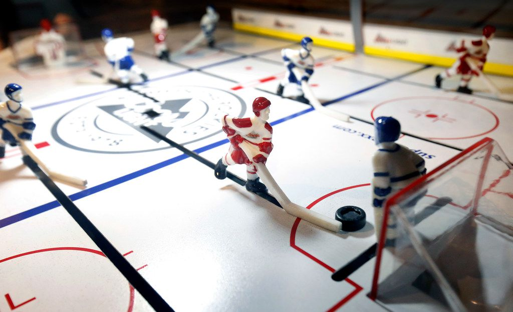 Bubble hockey is one of the numerous games you can play at Sports and Social at Texas Live in Arlington.