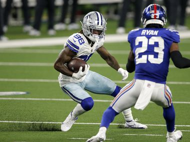 Dallas Cowboys wide receiver CeeDee Lamb (88) puts on the brakes as he avoids New York Giants cornerback Logan Ryan (23) after a fourth quarter pass completion at AT&T Stadium Stadium in Arlington, Texas, Sunday, October 11, 2020.