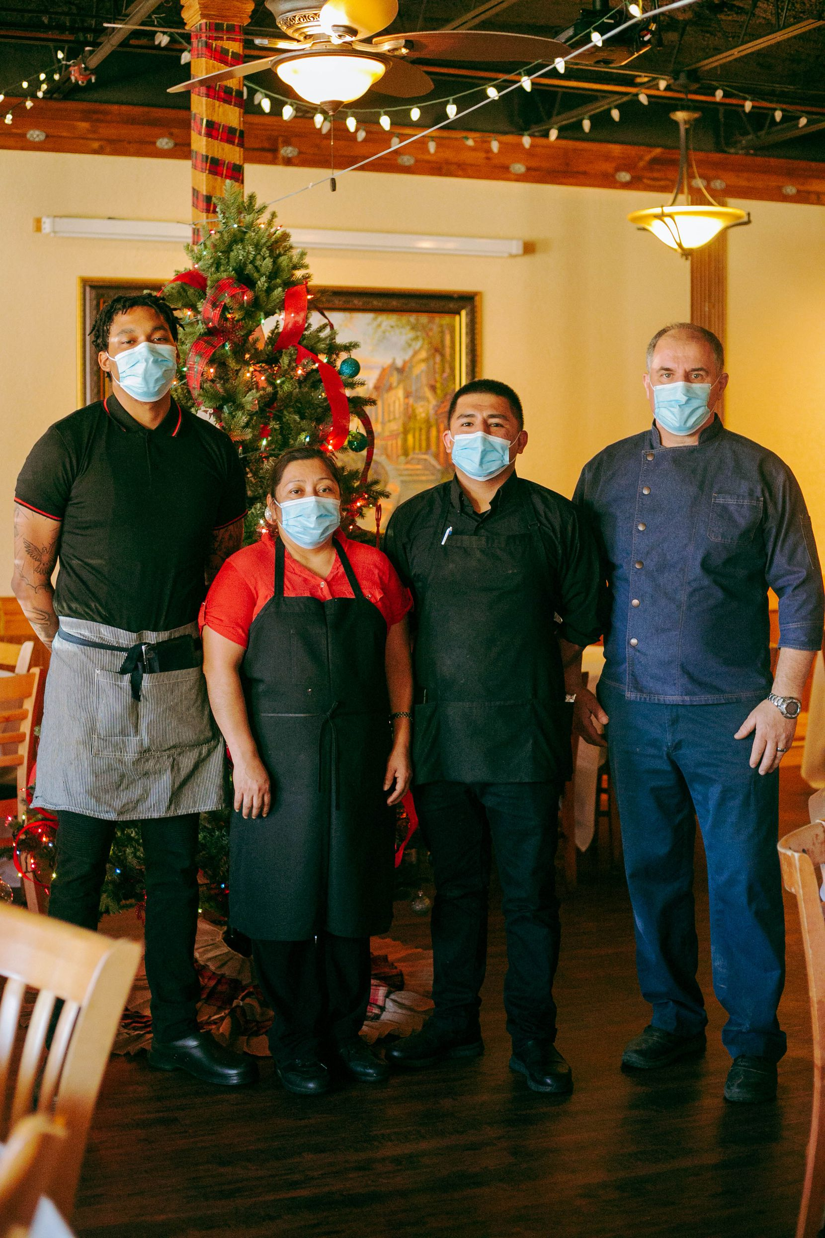 From left, Kyle Underwood, Candida Osilvo, Victor Caradilla, and Aboca's Italian Grill owner Artur Pira stand in Aboca's dining room on December 10, 2020.