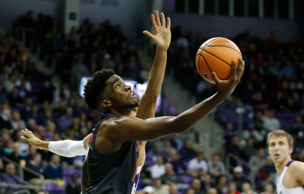 Southern Methodist Mustangs guard Shake Milton (1) attempts a layup after passing by TCU Horned Frogs guard Shawn Olden (2) during the first half of play at Schollmaier Arena at TCU in Fort Worth, on Tuesday, December 5, 2017. (Vernon Bryant/The Dallas Morning News)