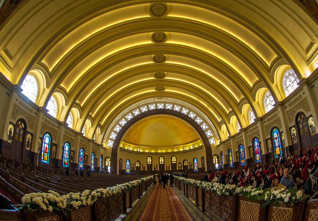 """Jan. 6, 2019 photo, people begin to gather at the new """"Cathedral of the Nativity of Christ,"""" before Christmas Eve Mass, in the new administrative capital, 40 kilometers (25 miles) east of Cairo, Egypt. On Sunday Egyptian President Abdel-Fattah el-Sissi, inaugurated the cathedral for the Coptic Orthodox Church and one of the region's largest mosques. Sunday's opening ceremony is a highly symbolic gesture at a time when Islamic militants are increasingly targeting the country's minority Christians."""