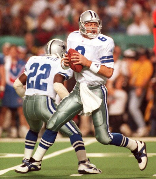 Cowboys quarterback Troy Aikman looks for a receiver in the first quarter of Super Bowl XXVIII against the Bills in Atlanta's Georgia Dome on Jan. 30, 1994.