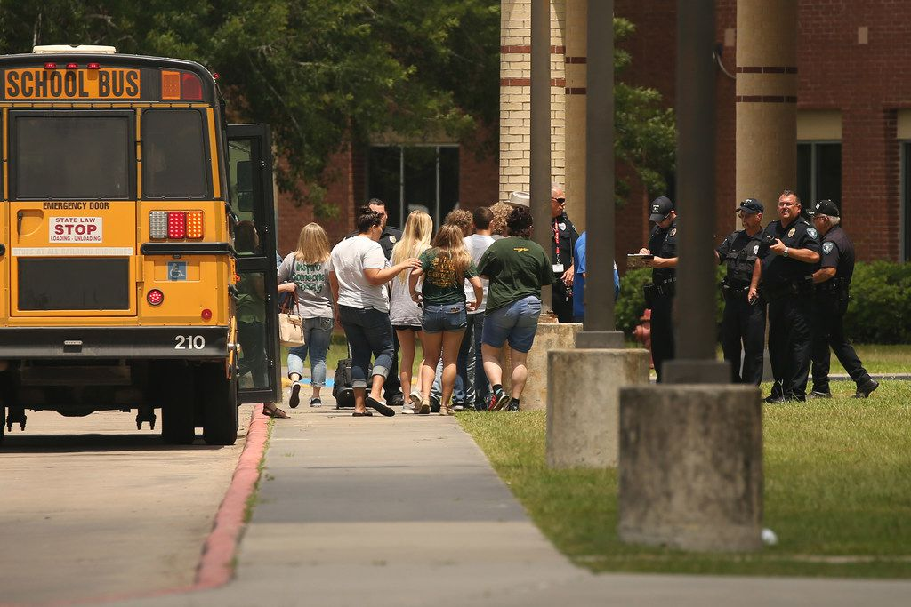 Guardians and students queued up after being transported by bus to gather belongings from Santa Fe High School on Saturday, their first chance to return to the school after the massacre.