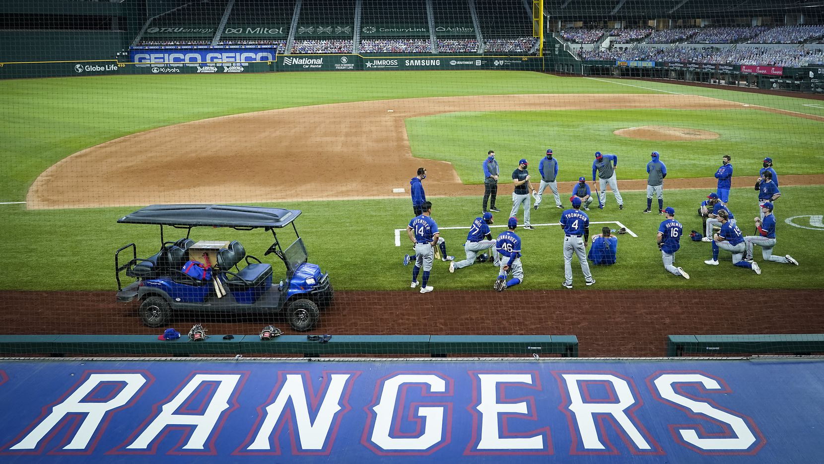 Texas Rangers players gather around field coordinator Matt Hagen following a game at the team's alternate training site at Globe Life Field on Saturday, Sept. 19, 2020.