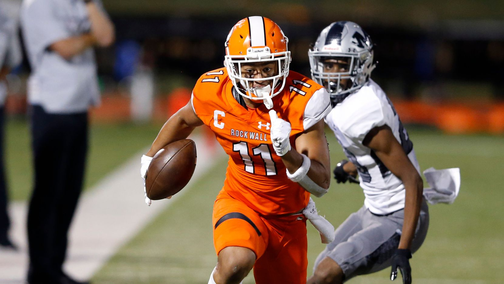 Rockwall's Jaxon Smith-Njigba (11) runs up the field after the catch in a game against Arlington Martin during the first half of play at Wilkerson-Sanders Memorial Stadium in Rockwall, Texas on Friday, September 20, 2019.