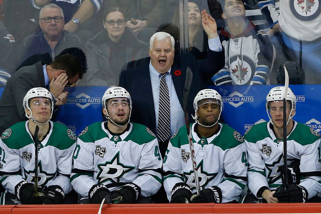 Dallas Stars head coach Ken Hitchcock challenges an apparent Winnipeg Jets goal during the second period of an NHL hockey game Thursday, Nov. 2, 2017, in Winnipeg, Manitoba. The goal was negated because of goalie interference. (John Woods/The Canadian Press via AP)