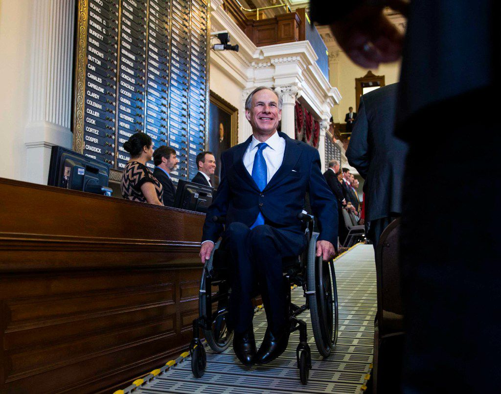 Texas Governor Greg Abbott makes his way out of the Texas House of Representatives after speaking during the first day of the 85th Texas Legislative Session on Jan. 10 at the Texas State Capitol in Austin. (Ashley Landis/The Dallas Morning News)