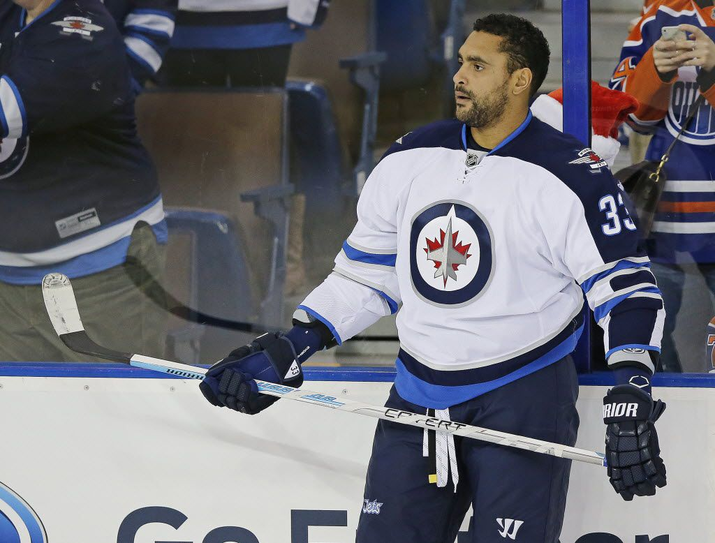 Dec 21, 2015; Edmonton, Alberta, CAN; Winnipeg Jets defensemen Dustin Byfuglien (33) skates on the ice during warmup prior to the game against the Edmonton Oilers at Rexall Place. Mandatory Credit: Perry Nelson-USA TODAY Sports