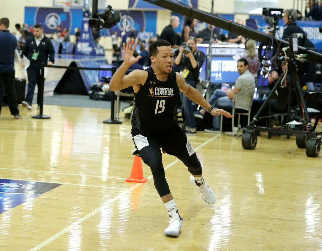 Jalen Brunson, from Villanova, participates in the NBA draft basketball combine Thursday, May 17, 2018, in Chicago. (AP Photo/Charles Rex Arbogast)