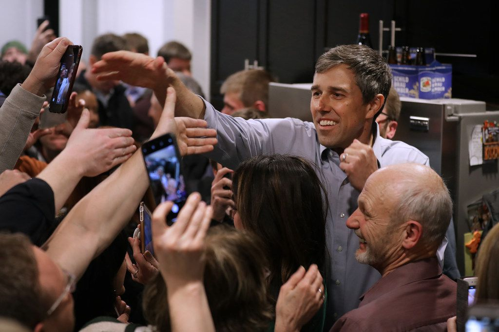 Democratic presidential candidate Beto O'Rourke shakes hands as he arrives at a packed St. Patrick's Day party at the home of County Recorder John Murphy March 16, 2019 in Dubuque, Iowa. After losing a long-shot race for U.S. Senate to Ted Cruz (R-TX), the 46-year-old O'Rourke is making his first campaign swing through Iowa after jumping into a crowded Democratic field this week.