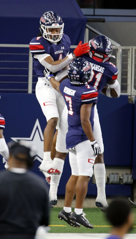 Denton Ryan's Ty Marsh (4) celebrates his touchdown with teammates in the end zone during the first half of the Class 5A Division I state semifinal football playoff game against the Mansfield Summit High at AT&T Stadium in Arlington on Friday, January 8, 2021. (John F. Rhodes / Special Contributor)