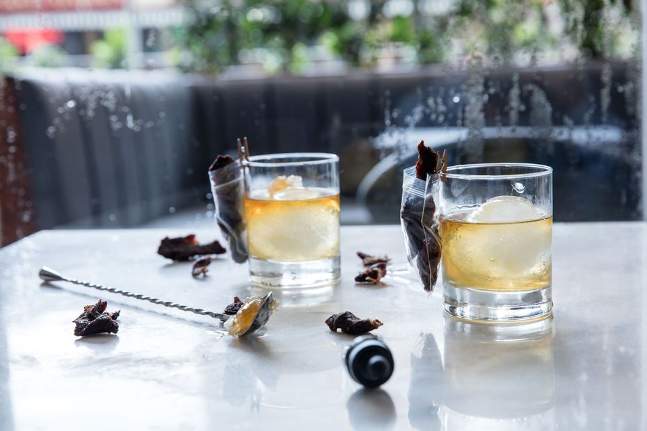 The Beef & Bourbon drink comes with a side of beef jerky clothespinned to the cocktail glass.