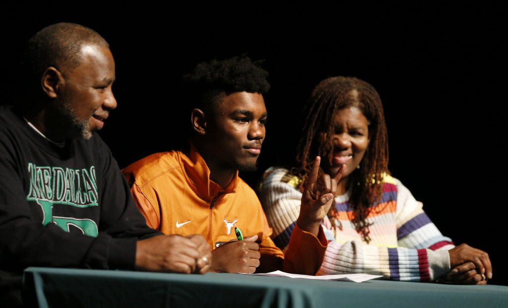 Kobe Boyce of Lake Dallas High School poses for photos with his parents David Boyce and Mary Flowers Boyce after signing his letter of intent to play football at the University of Texas during signing day at Lake Dallas High School on Wednesday, February 1, 2017.