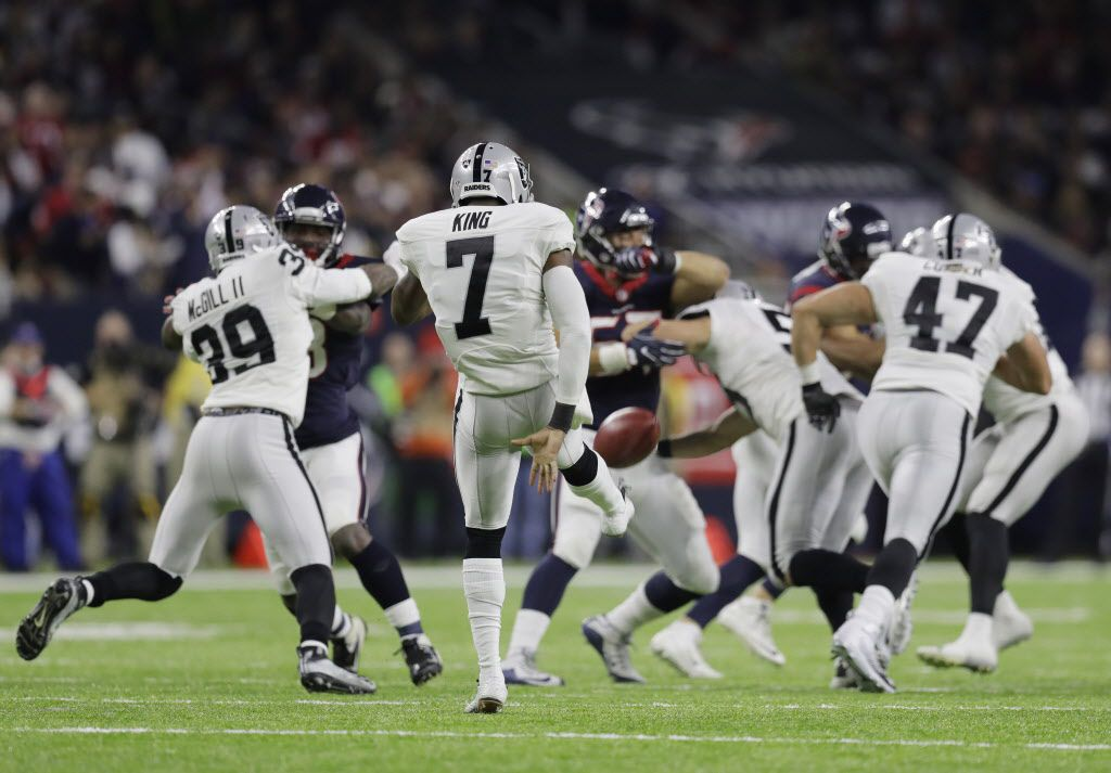 Oakland Raiders punter Marquette King (7) kicks away against the Houston Texans during the second half of an AFC Wild Card NFL football game Saturday, Jan. 7, 2017, in Houston. (AP Photo/Eric Gay)