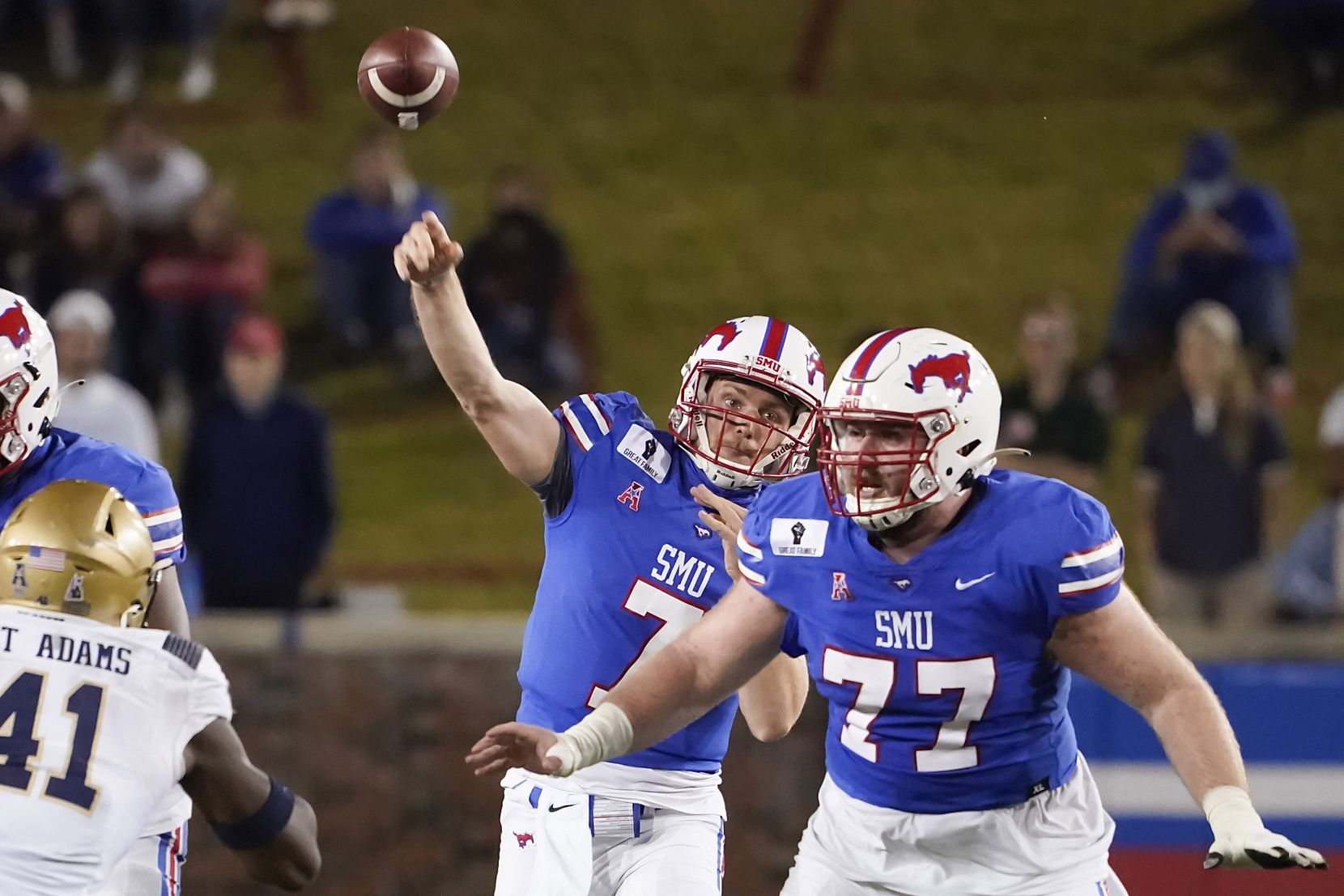 SMU quarterback Shane Buechele (7) throws a pass behind the protection of SMU offensive lineman Alan Ali (77) during the second quarter of an NCAA football game against Navy at Ford Stadium on Saturday, Oct. 31, 2020, in Dallas.