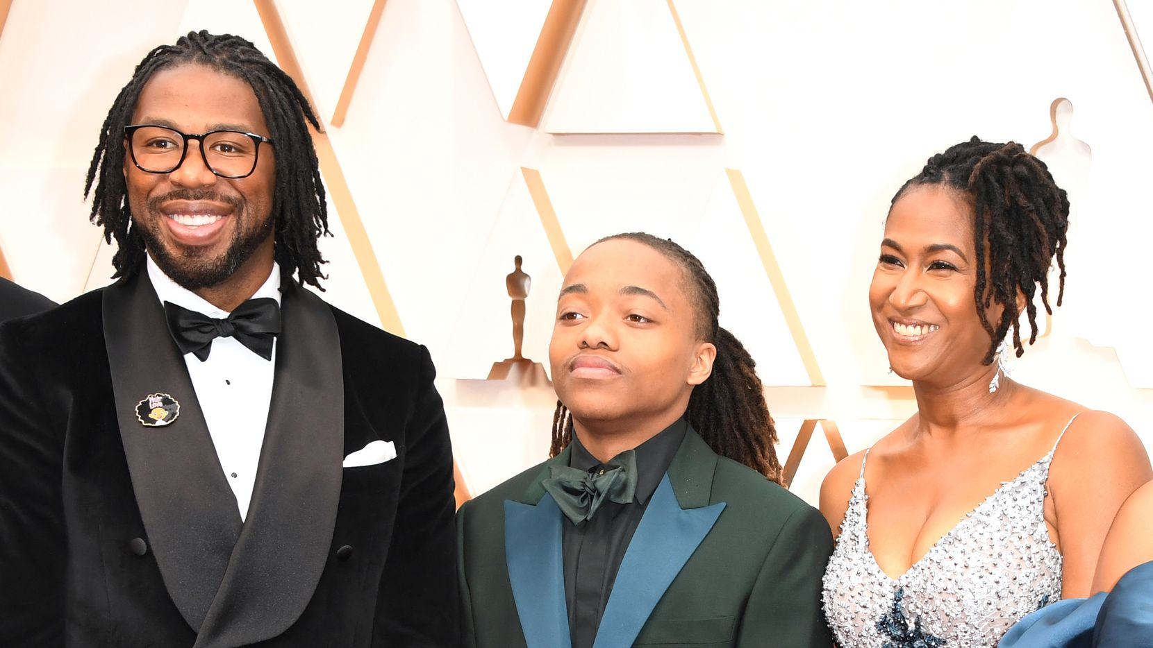 US director Matthew A. Cherry, left, US producer Karen Rupert Toliver, right, and Deandre Arnold, the Texas teen who was told his dreadlocks violated school dress code, arrive for the 92nd Oscars at the Dolby Theatre in Hollywood, California on February 9, 2020.