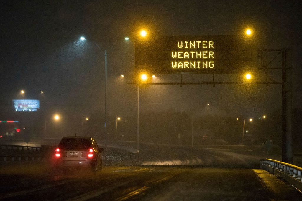 A Winter weather warning sign along Texas State Highway 286 as Snow falls in Corpus Christi on Texas, Friday, Dec. 8,2017.