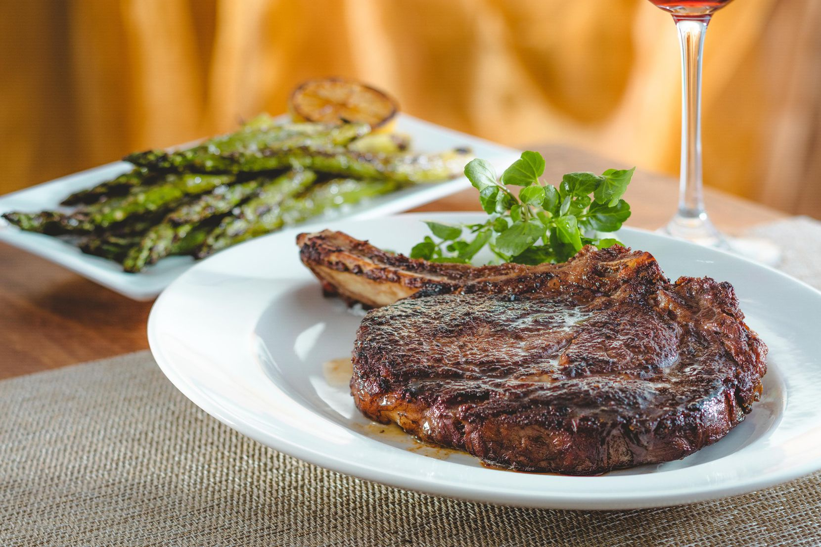 The Capital Grille offers ready-to-grill uncooked steaks including 22-ounce bone-in prime rib-eyes for Memorial Day weekend.