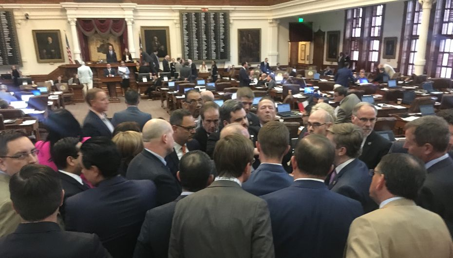 House members huddled at the back of the chamber late Thursday after Rep. Jonathan Stickland, center, and fellow Freedom Caucus members protested what they described as petty punishments by Speaker Joe Straus and his allies.