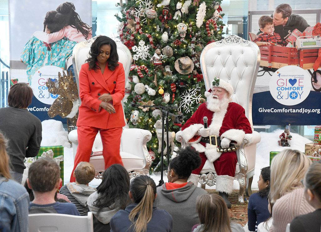 Former first lady Michelle Obama dances after a patient at Children's Hospital Colorado in Aurora, Colo., asks her about her favorite moves.