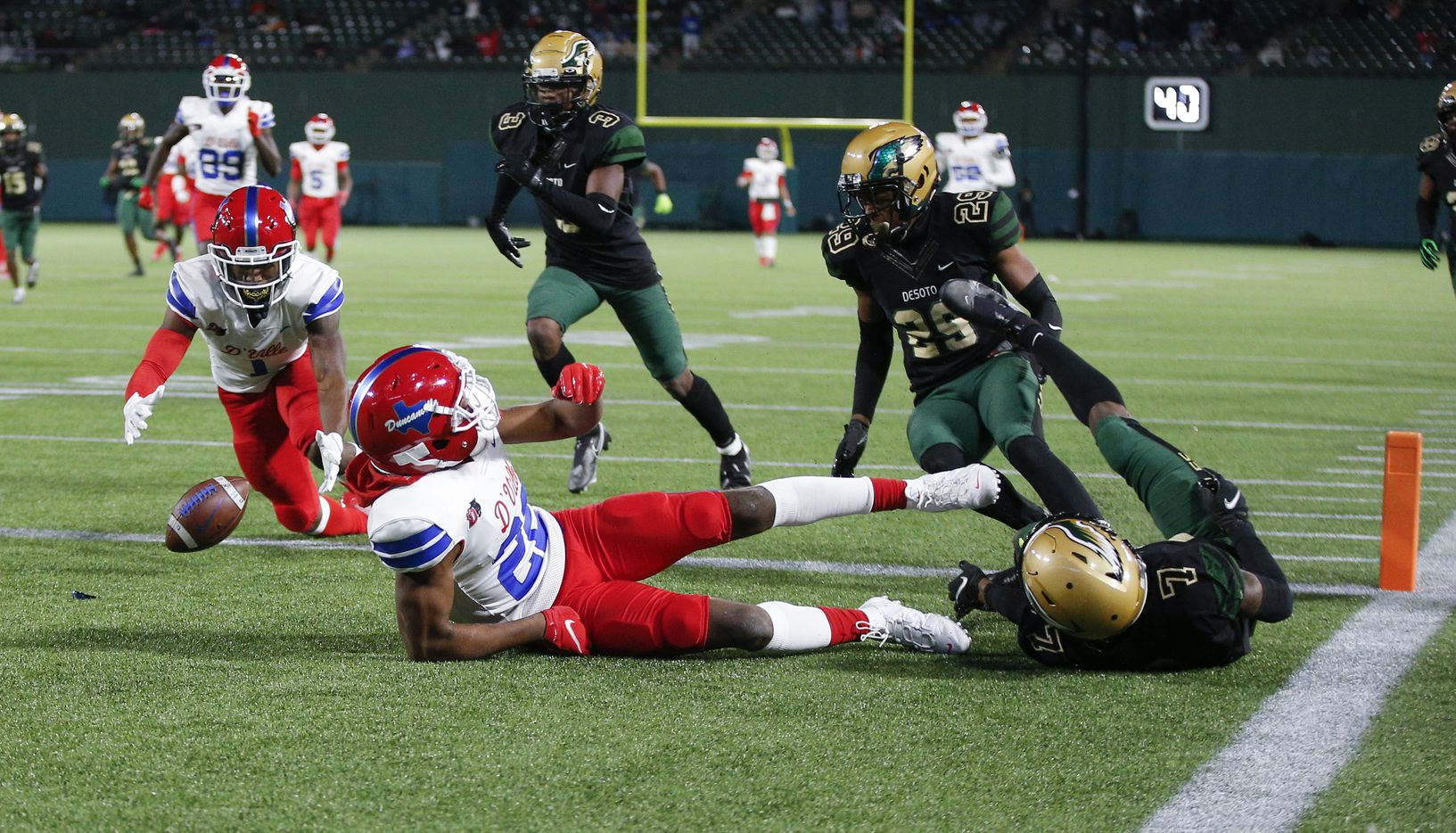 Duncanville sophomore wide receiver Lontrell Turner (22) fumbles the ball short of the end zone during the first half of a Class 6A Division I Region II final high school football game against DeSoto, Saturday, January 2, 2021. Duncanville junior running back Chris Hicks (1) would recover the ball in the end zone for the touchdown. Duncanville won 56-28. (Brandon Wade/Special Contributor)