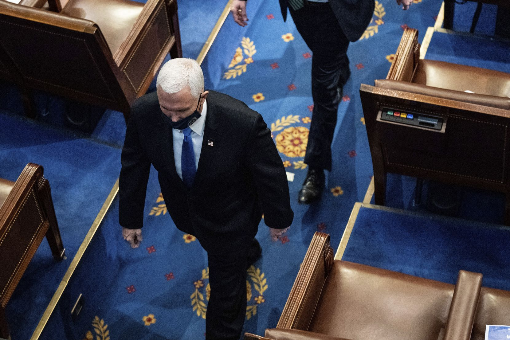 Vice President Mike Pence walks off the House floor as a joint session of the House and Senate convenes to confirm the Electoral College votes cast in November's election, at the Capitol in Washington, Wednesday, Jan. 6, 2021.