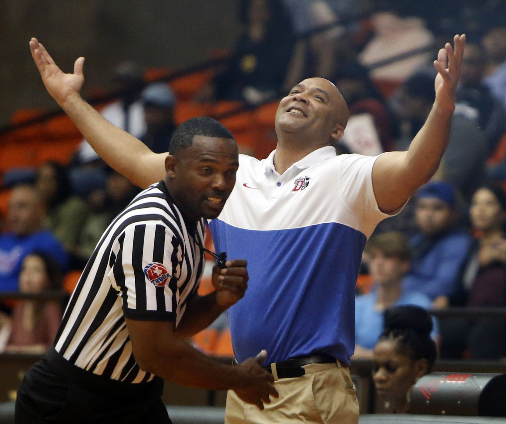 Duncanville head coach David Peavy reacts after his case on a missed call appeared to fall on deaf ears as the game official turns back to the action on the court during the second half of play. Duncanville prevailed 59-43 to gain a berth in the UIL state tournament. The two teams played in the Class 6A Region 1 championship boys basketball playoff game at Wilkerson-Greines Activity Center in Fort Worth on March 7, 2020.