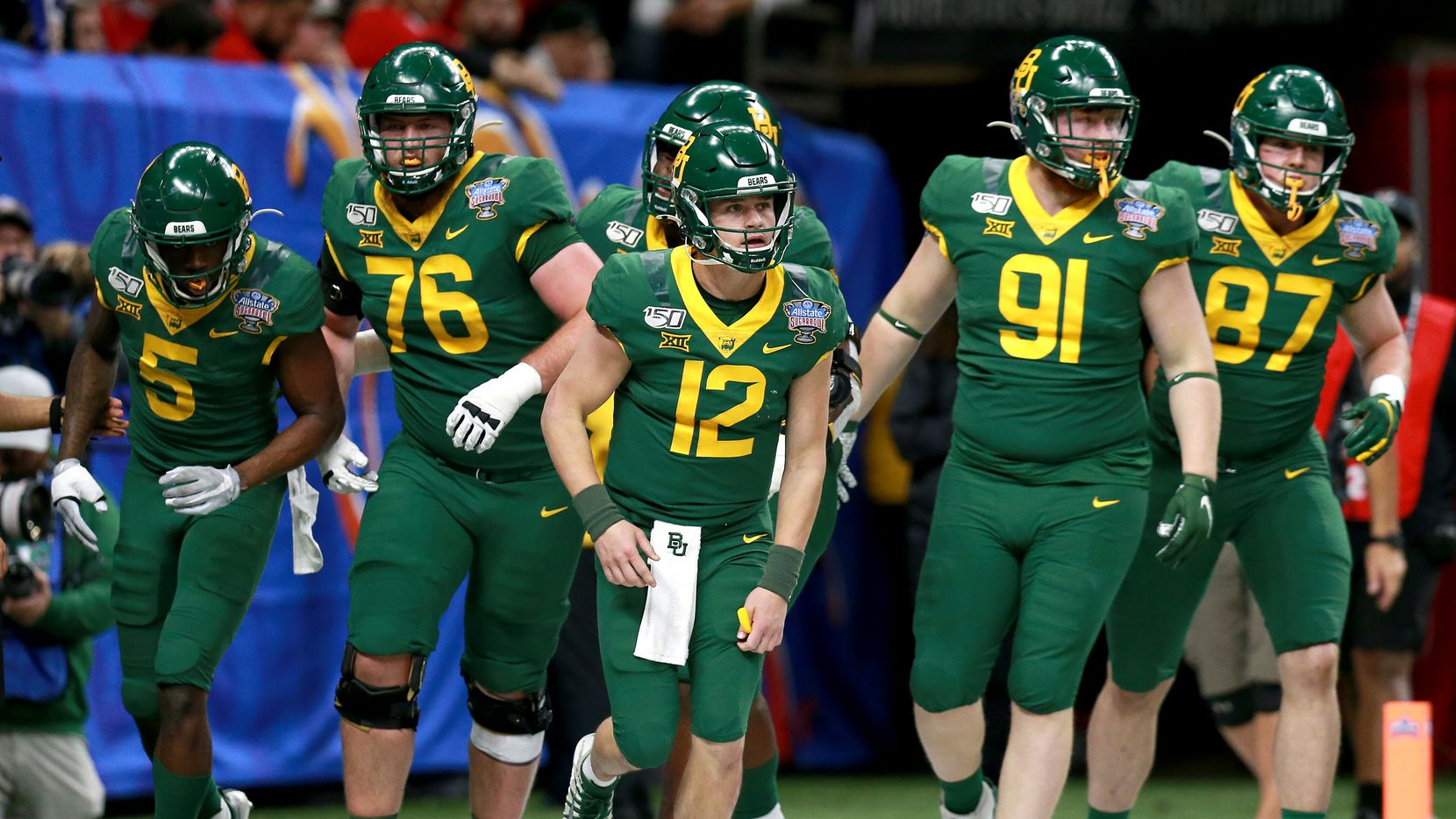 FILE — Charlie Brewer #12 of the Baylor Bears reacts with teammater after his team scored a touchdown against the Georgia Bulldogs during the Allstate Sugar Bowl at Mercedes Benz Superdome on January 01, 2020 in New Orleans, Louisiana.