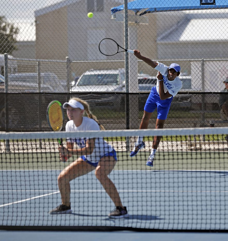 In a 6A mixed doubles match, Plano West's Summer Shannon waits as Purushotham Koduri serves. UIL state tennis semifinals at Northside ISD Tennis Center on Thursday, May 20, 2021.