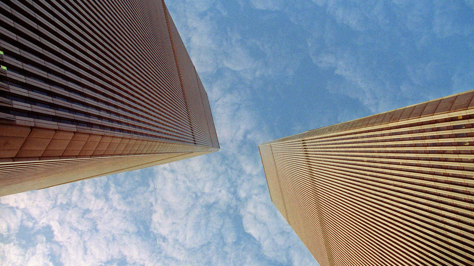 This file photo taken November 8, 1992 shows the twin towers of the World Trade Center, in lower Manhattan, New York.  On the morning of Tuesday Sept. 11, 2001, New Yorkers woke to crisp blue skies following a storm that had soaked America's northeastern seaboard the day before. The cloudless, beautiful sky was little portent of the dark, history-changing day that was to come but would remain etched on the memory of those involved.