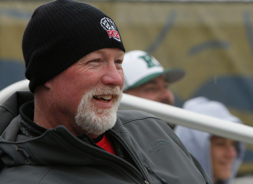 Rusty Greer, former Texas Rangers outfielder and Rangers Hall of Fame player, smiles as he watches his son Mason hit a ball toward the left field fence during a scrimmage against host Keller on February 16, 2019. Mason, the starting 3rd baseman for Colleyville Heritage, deals with Type1 diabetes as he prepares to contribute to Auburn's college baseball program and perhaps a pro baseball career. (Steve Hamm/ Special Contributor)