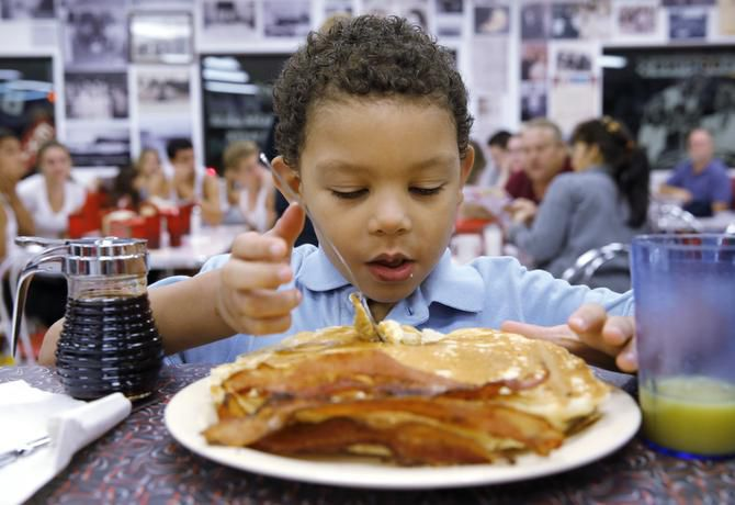 Brian Armes, 5, got ready to dig into a stack of pancakes at Big State Fountain Grill on Monday.