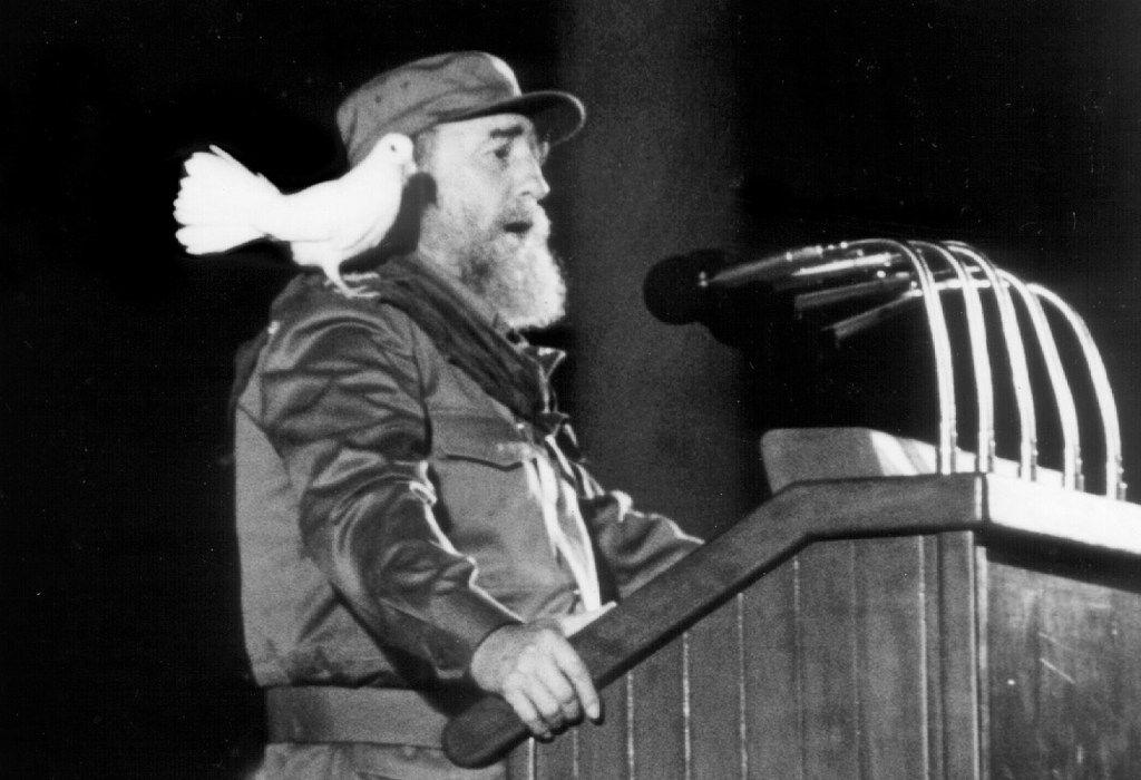 In this Jan. 8, 1989 file photo, a white dove lands on Cuban president Fidel Castro's shoulder as he delivers a speech to Cuban youth at a ceremony to commemorate the 30th Anniversary of the Cuban Revolution in Havana.